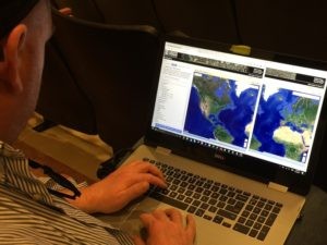 data rescuer working with government data sets on laptop